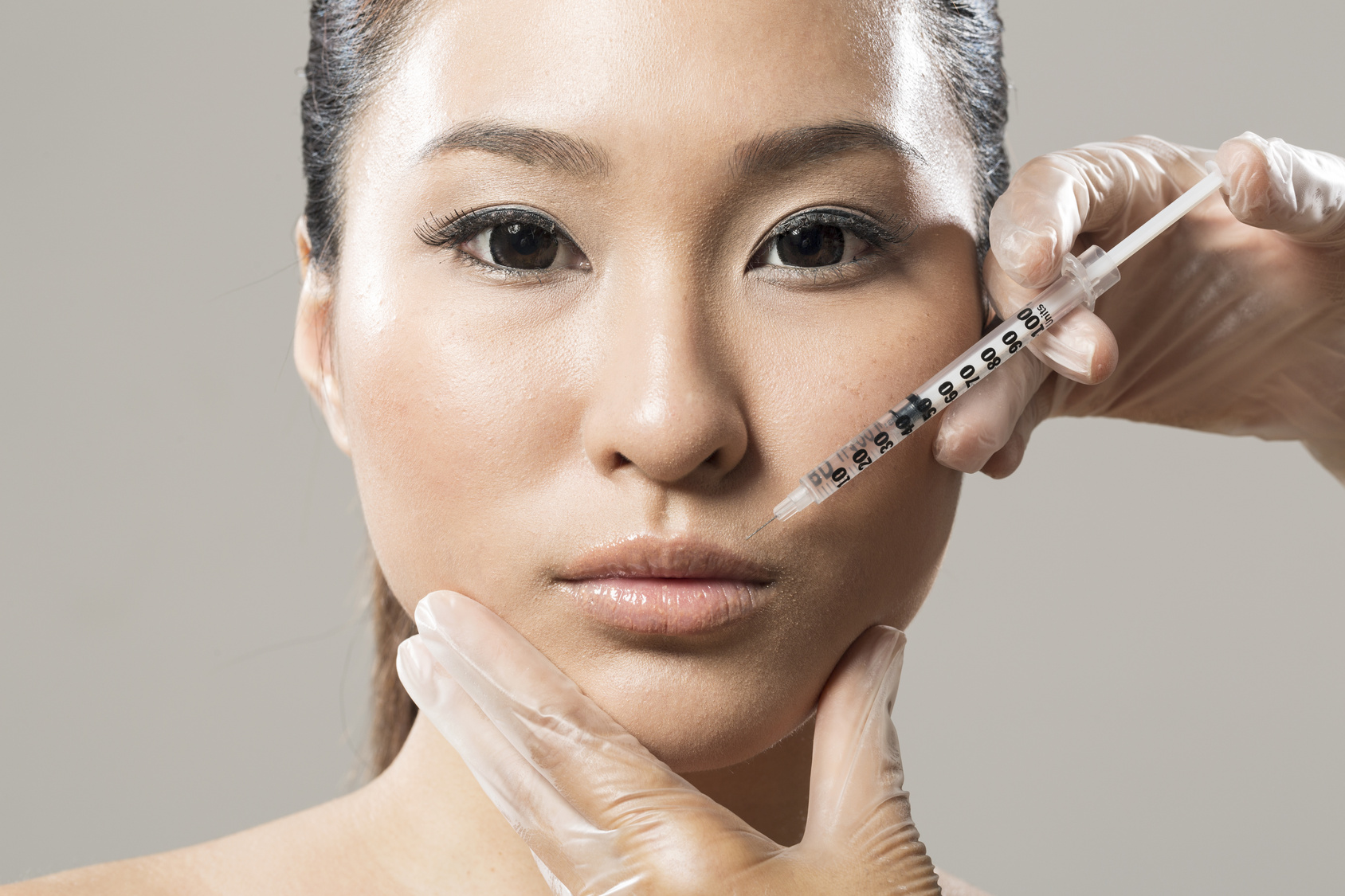 Chinese woman receiving a botox injection.